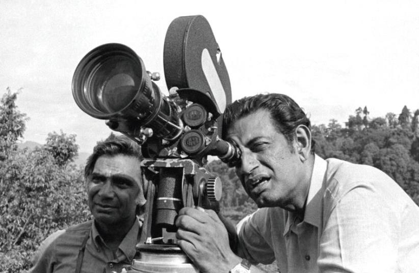 INDIAN FILMMAKER Satyajit Ray on the set of his first film, 'Pather Panchali,' in 1955 (photo credit: IMDB.COM)