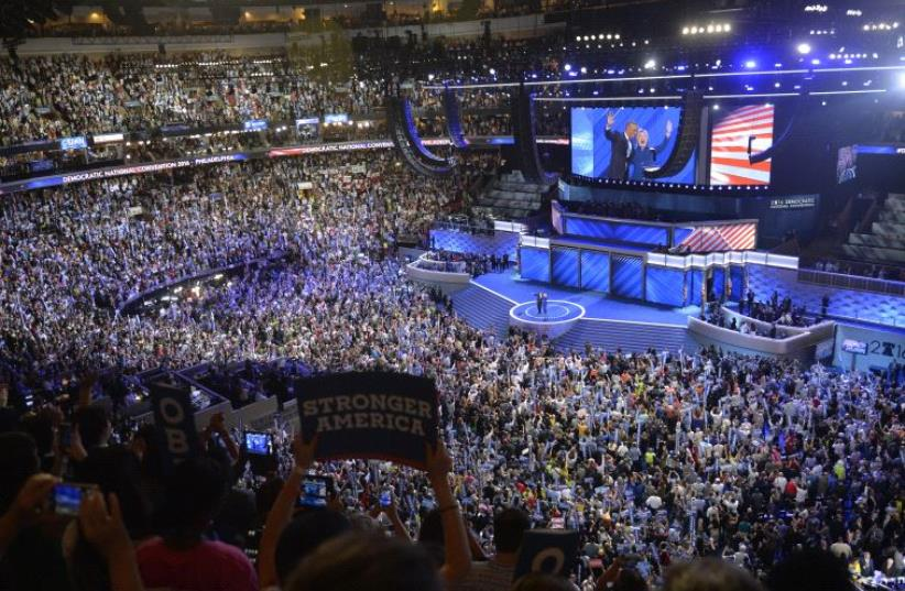US President Barack Obama and Democratic Nominee for President Hillary Clinton wave at the Democratic National Convention in Philadelphia, Pennsylvania, July 27, 201 (photo credit: REUTERS)