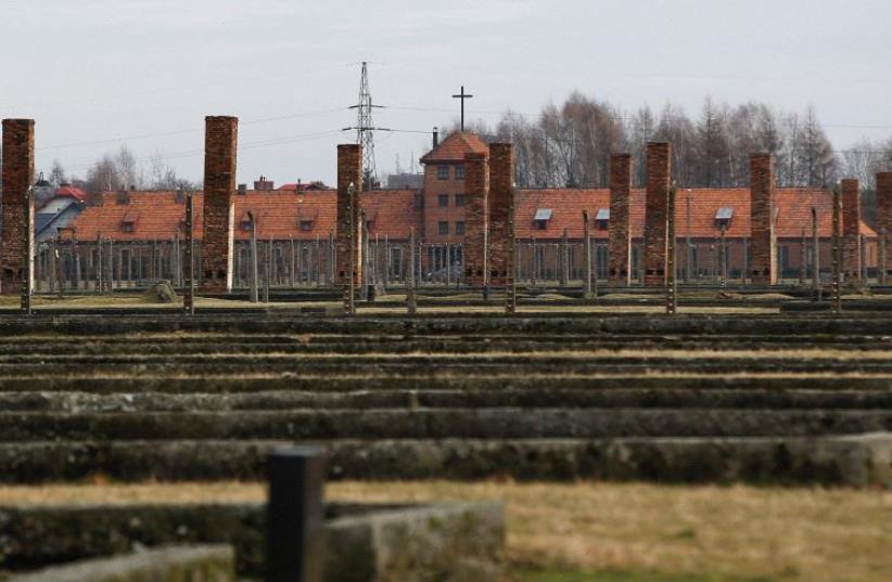 A CROSS is seen in the German death camp Auschwitz II Birkenau. (photo credit: REUTERS)
