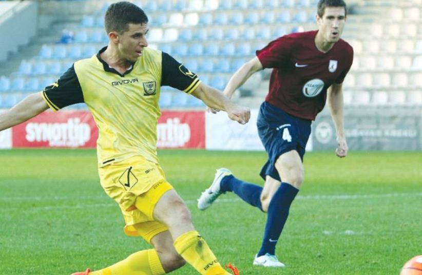 Beitar Jerusalem midfielder Idan Vered nets his team's opener in last night's 1-1 draw against Jelgava in Latvia in the first leg of the Europa League third qualifying round. (photo credit: UDI ZITIAT)