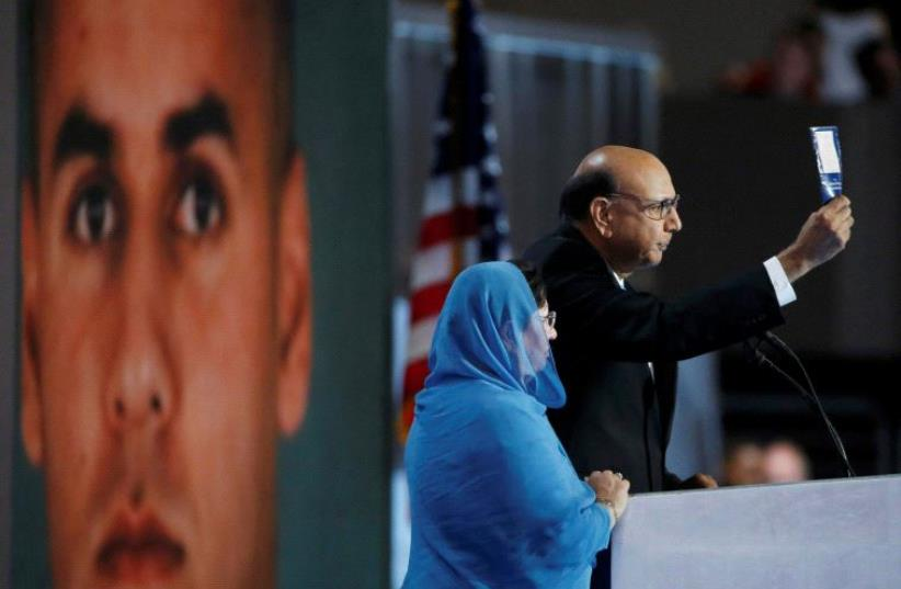 Khizr Khan, who's son Humayun (L) was killed serving in the US Army, challenges Republican presidential nominee Donald Trump to read his copy of the US Constitution, at the Democratic National Convention in Philadelphia, Pennsylvania July 28, 2016 (photo credit: REUTERS)