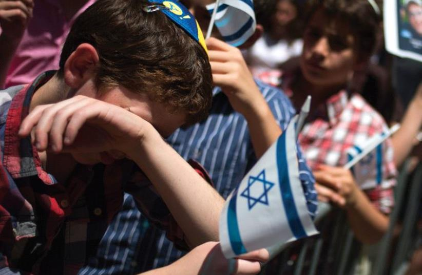 AMERICANS attend a protest on behalf of three teens murdered by Palestinians in 2014. (photo credit: REUTERS)
