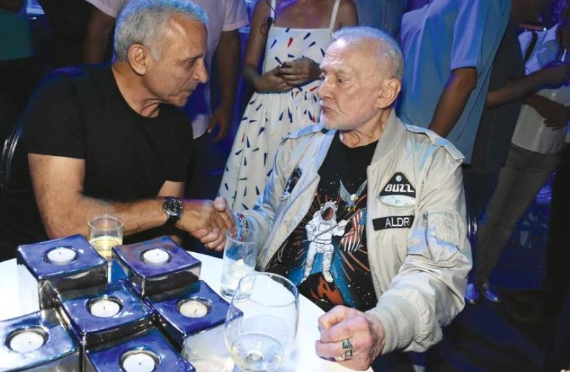 EITAN BEN ELIYAHU (left) and Buzz Aldrin. (photo credit: AVIV HOFI)