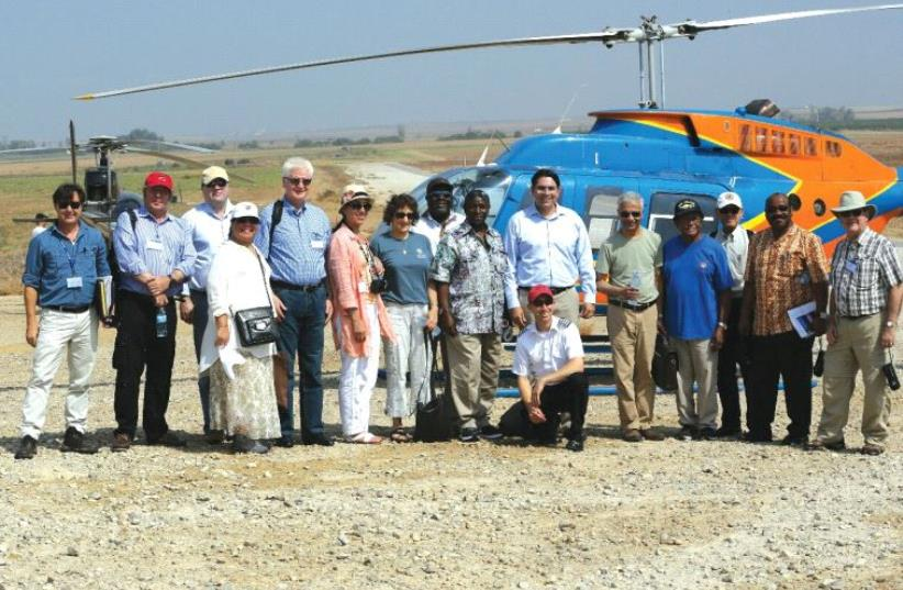 AMBASSADOR TO the UN Danny Danon (standing behind the kneeling man) and 11 of his colleagues from the world body visit the South yesterday. (photo credit: AVI DODI)