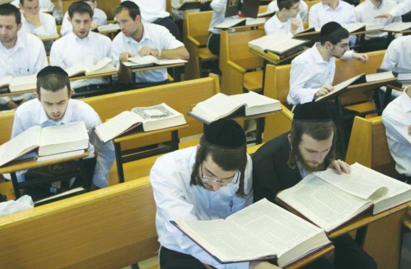 ULTRA-ORTHODOX STUDENTS study at Jerusalem's Mir Yeshiva. (photo credit: REUTERS)