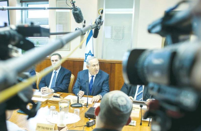 PRIME MINISTER Benjamin Netanyahu addresses a recent weekly cabinet meeting in Jerusalem (photo credit: REUTERS)
