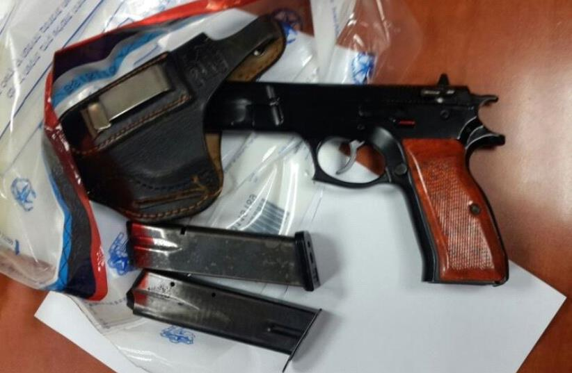 The gun and cartridges seized by police. (photo credit: ISRAEL POLICE)
