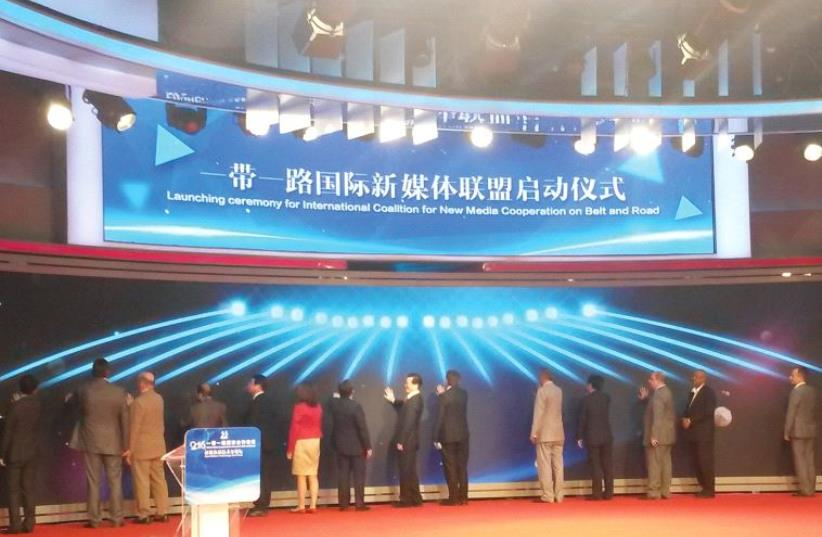 FOREIGN MEDIA outlets pledge to join the 'International Coalition for New Media Cooperation on One Belt and One Road' in Beijing in late July.  (photo credit: AMY SPIRO)