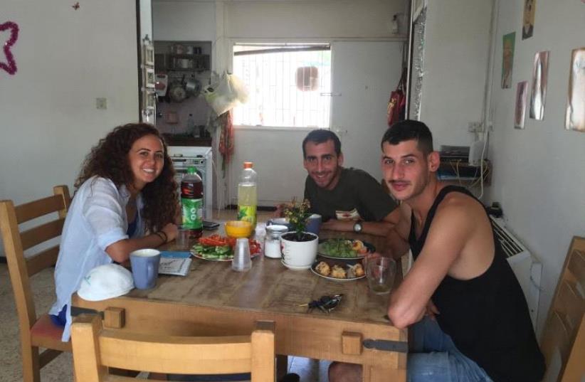 Adi Treves, Itay Itamar and Yotam Rechnitz of the Beersheba Moishe House. (photo credit: TAMARA ZIEVE)