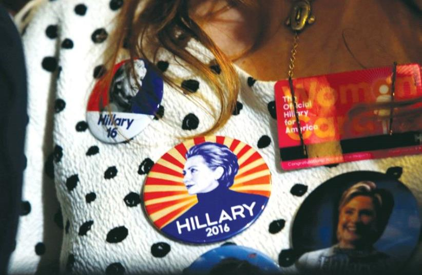 A SUPPORTER wears Democratic US presidential nominee Hillary Clinton buttons during a Clinton campaign rally in Las Vegas, Nevada, on August 4. (photo credit: REUTERS)
