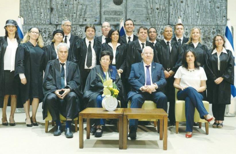 PRESIDENT REUVEN RIVLIN (seated, second from right) poses in front of newly appointed judges and registrars at a ceremony at the President's Residence yesterday. Also seated (left to right) are National Labor Court President Yigal Plitman, Supreme Court President Miriam Naor and Justice Minister Aye (photo credit: Mark Neiman/GPO)
