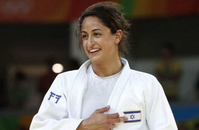 Yarden Gerbi celebrates after defeating Japan's Miku Tashiro during their women's -63kg judo contest bronze medal A match of the Rio 2016 Olympic Games in Rio de Janeiro on August 9, 2016 (photo credit: JACK GUEZ / AFP)