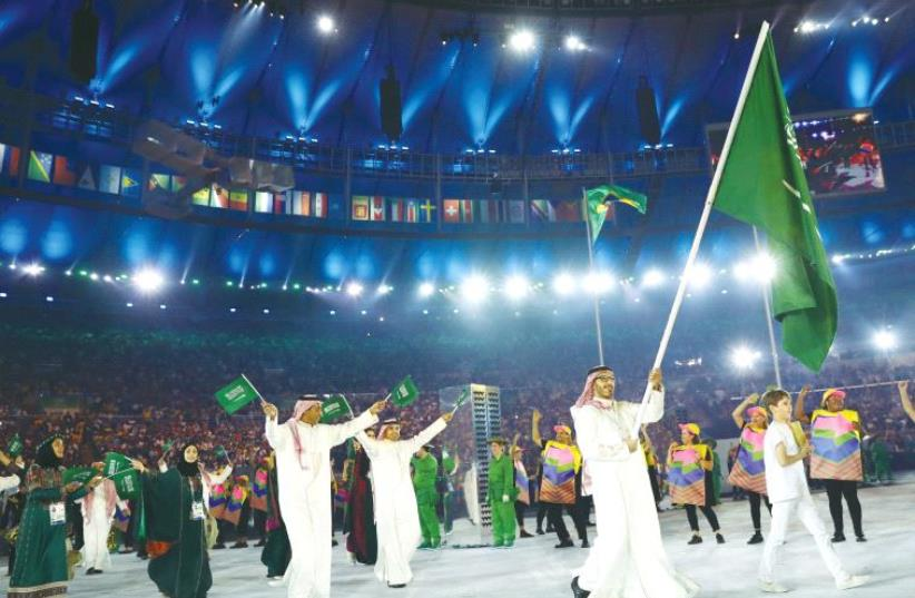 THE SAUDI ARABIAN delegation arrives at the Olympic opening ceremony in Brazil. (photo credit: REUTERS)