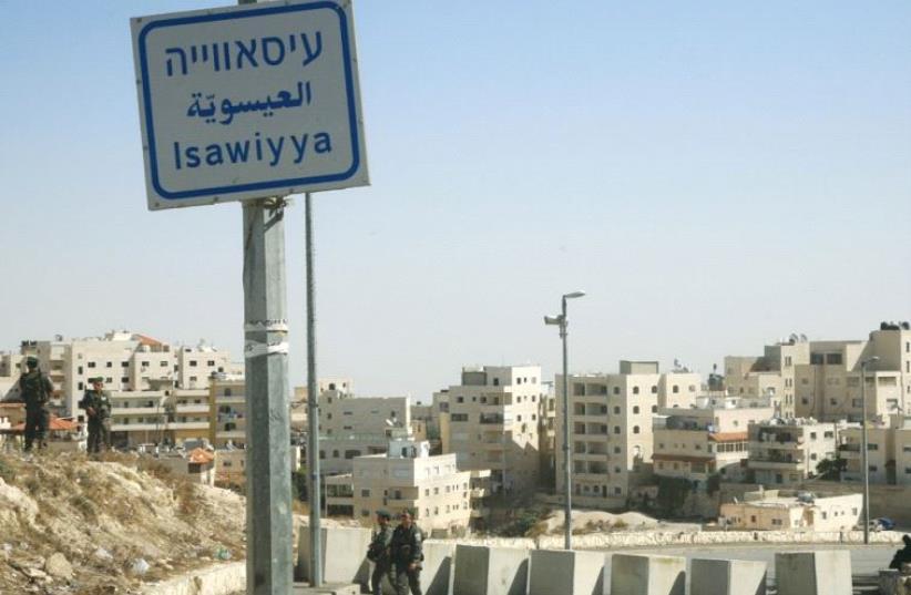 POLICE PATROL at the entrance to the east Jerusalem neighborhood of Isawiya. (photo credit: MARC ISRAEL SELLEM)