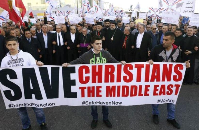Assyrians march in solidarity with those abducted by Islamic State fighters in Syria, in Beirut, in 2015 (photo credit: REUTERS)