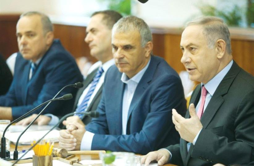PRIME MINISTER Benjamin Netanyahu praises the new budget before the cabinet debate yesterday. (photo credit: REUTERS)