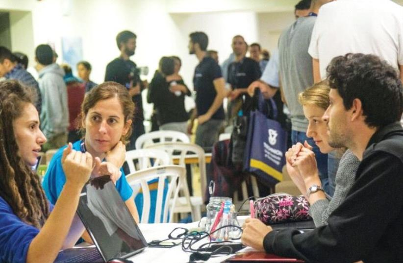 HACKATHONERS DISCUSS 'hasbara' ideas last week at the Technion (photo credit: DAR COHEN)