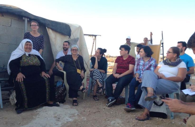 Jews listening to a Sussiya resident (photo credit: ELIYAHU KAMISHER)