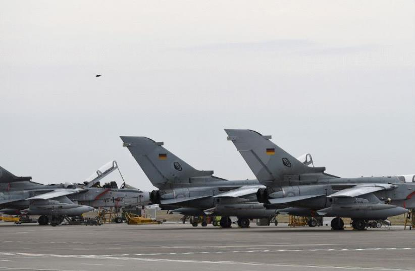 German Tornado jets are pictured on the ground at the air base in Incirlik, Turkey, January 21, 2016 (photo credit: REUTERS)