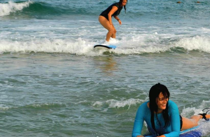 Maya Surf students practice catching a wave (photo credit: INBAL AHARONI)