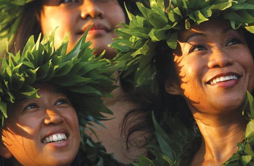 DANCERS PERFORMING at the Waikiki Shell on Waikiki Beach in Honolulu, Hawaii. (photo credit: REUTERS)