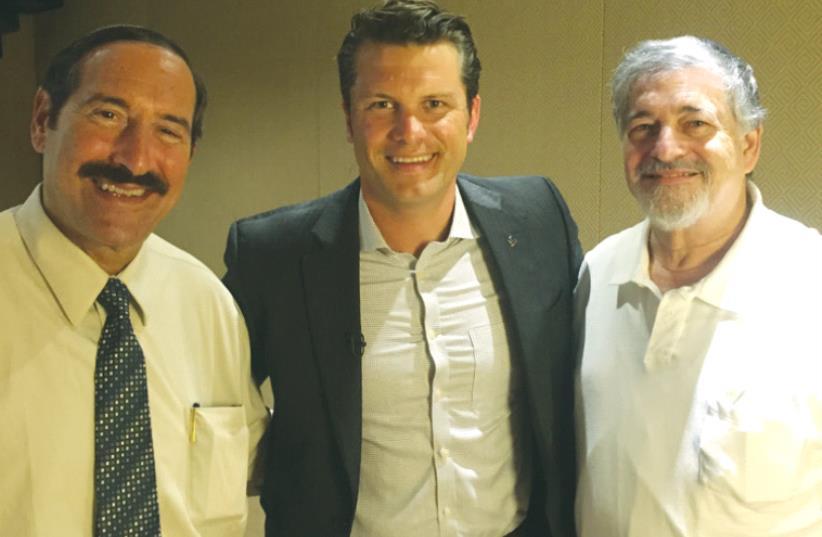 JOE FRAGER (left), Pete Hegseth (center) and Paul Brody pose at the King David Hotel in Jerusalem (photo credit: SETH J. FRANTZMAN)