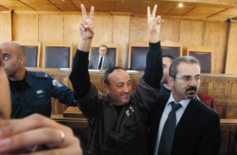 Marwan Barghouti, seen here at the Jerusalem Magistrates' Court in 2012, is currently serving five life sentences for murder (photo credit: REUTERS)