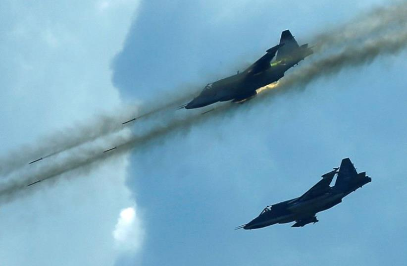 Russian Sukhoi Su-25 jet fighters (photo credit: REUTERS)