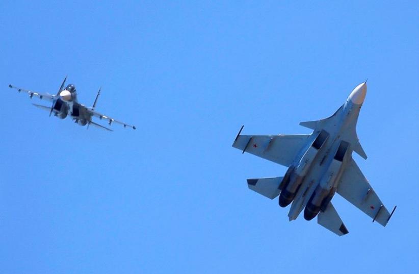 Russian Sukhoi Su-30SM jet fighters (photo credit: REUTERS)