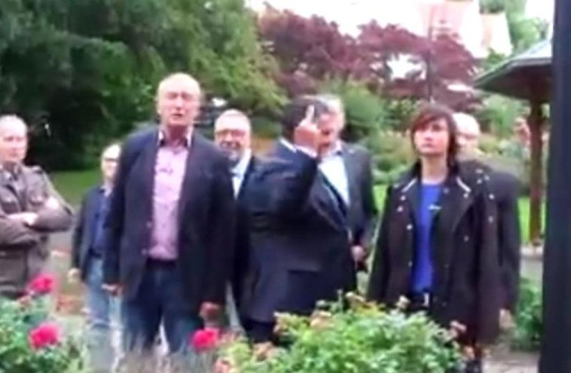 Germany's Vice-Chancellor Sigmar Gabriel gives the middle finger to neo-Nazi protestors (photo credit: screenshot)