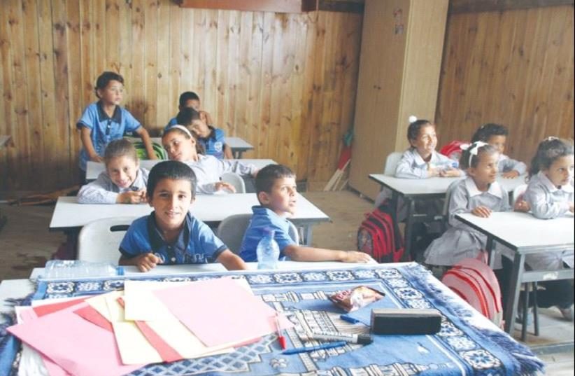 CHILDREN SIT at a Beduin school in al Khan al Amar in the West Bank yesterday. The school is slated for demolition. (photo credit: TOVAH LAZAROFF)