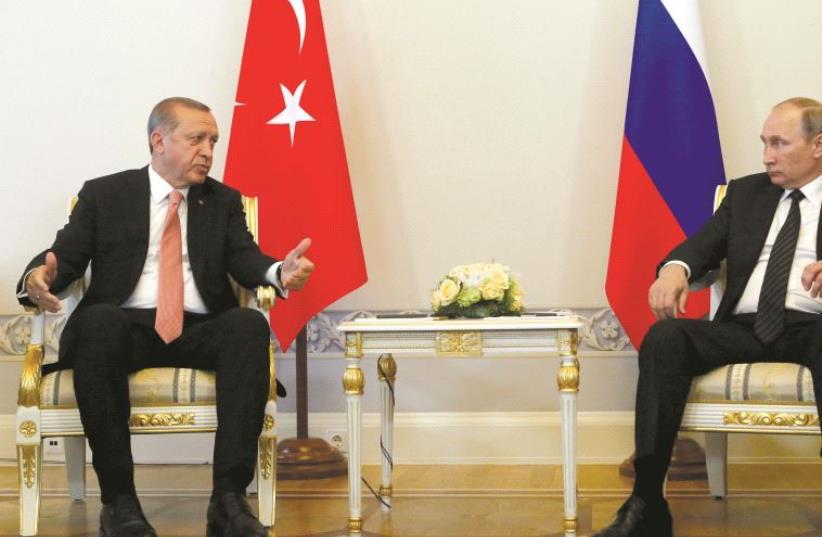 """Erdogan et Poutine, désormais """"amis"""" ? (photo credit: REUTERS)"""