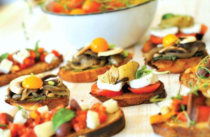 Bruschetta with tomatoes, basil and salty cheese (photo credit: PASCALE PEREZ-RUBIN)