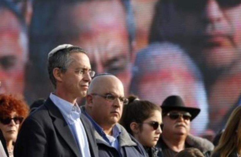 The sons of former prime minister Ariel Sharon, Gilad (L) and Omri (2nd L) (photo credit: REUTERS/BAZ RATNER)