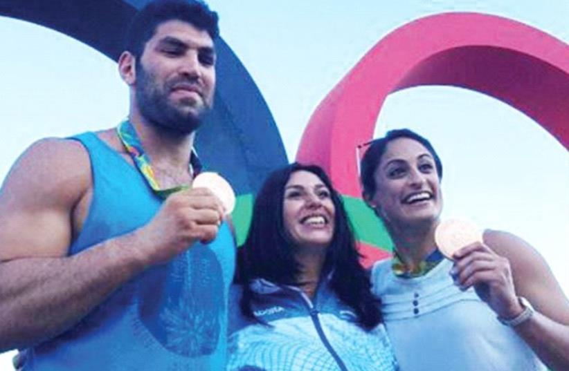 ISRAELI JUDKOAS Yarden Gerbi (right) and Ori Sasson (left), posing with Culture and Sport Minister Miri Regev, won the blue-and-white's lone medals at the Rio Olympics which came to a close on Sunday night. (photo credit: Courtesy)