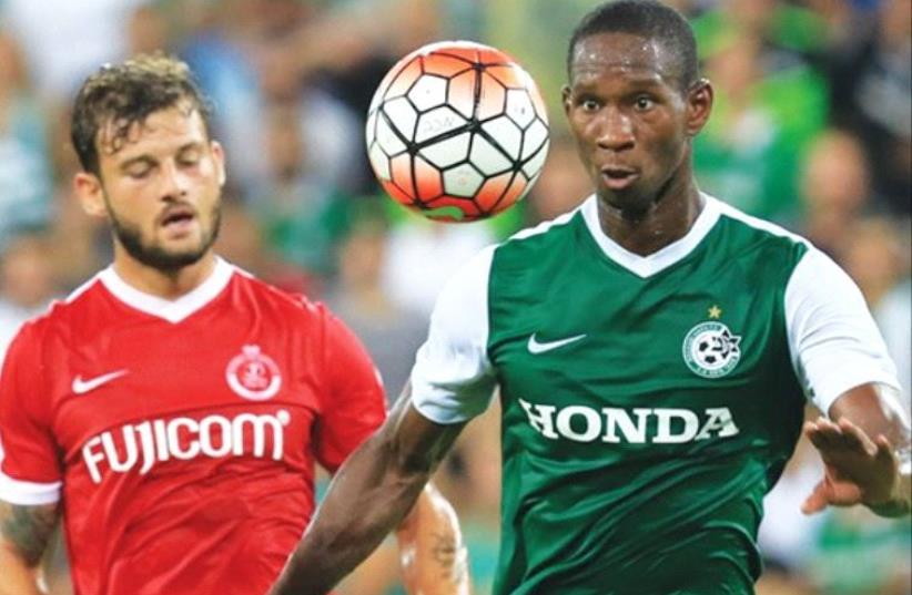 Maccabi Haifa striker Glynor Plet (right) scored the winner in last night's 1-0 win over Adi Gotlieb (left) and Hapoel Tel Aviv at Haifa Stadium. (photo credit: ERAN LUF)