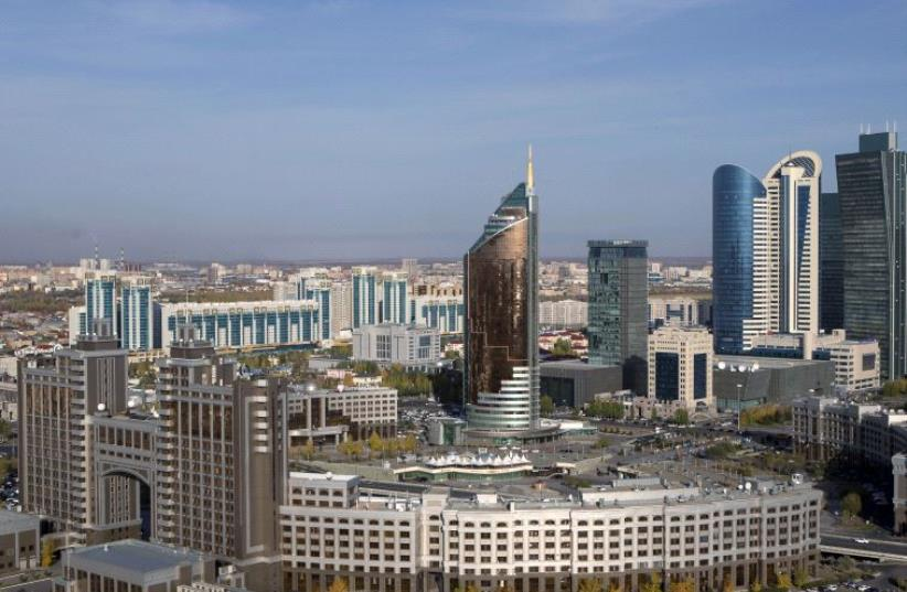 A general view of downtown with Kazakhstan's national oil company KazMunayGas (KMG) headquarters (front) in Astana, Kazakhstan. (photo credit: REUTERS)
