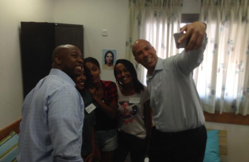 Senator Cory Booker and Tim Scott take a selfe with Ramla youth. (photo credit: ELIYAHU KAMISHER)