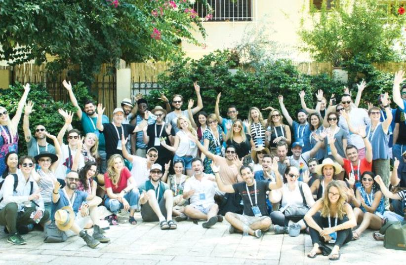 'Reality Storytellers' pose in front of the Suzanne Dellal Center for Dance and Theater in Tel Aviv's Neveh Tzedek neighborhood last Monday (photo credit: SCHUSTERMAN FOUNDATION)
