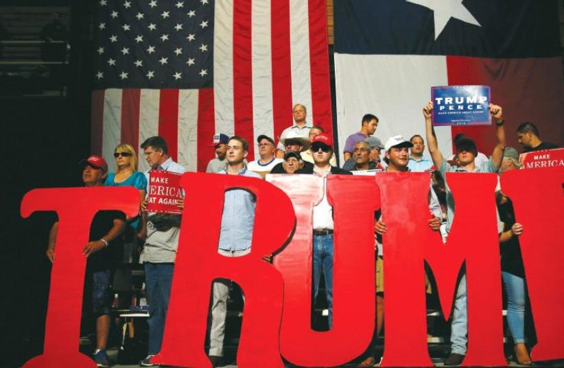 PEOPLE HOLD up letters that spell 'Trump' as Republican presidential nominee Donald Trump speaks during a rally in Austin, Texas, earlier this year (photo credit: REUTERS)