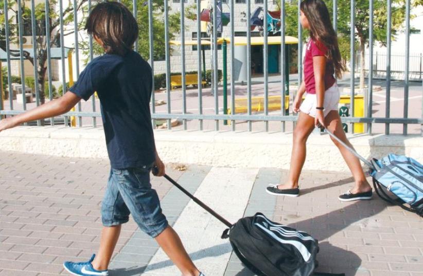Children walking to school (photo credit: MARC ISRAEL SELLEM/THE JERUSALEM POST)