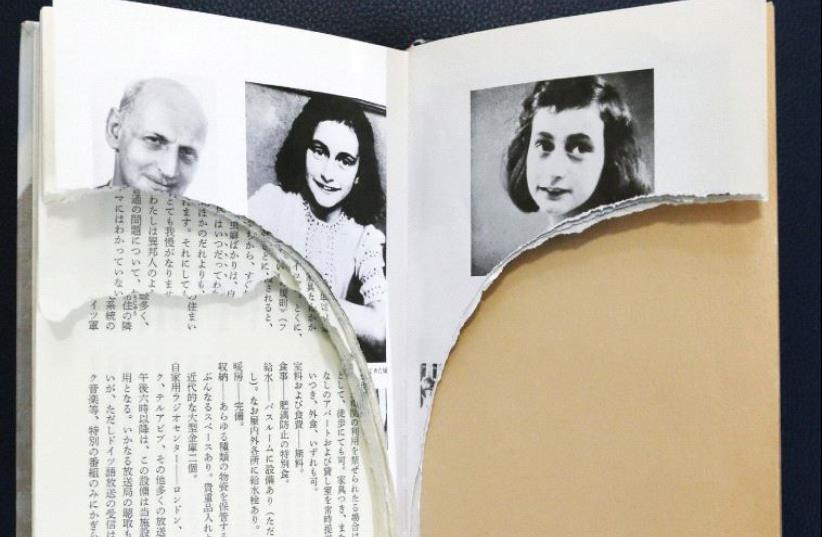 RIPPED PAGES of Anne Frank's 'Diary of a Young Girl' are pictured at a library in Tokyo. (photo credit: REUTERS)