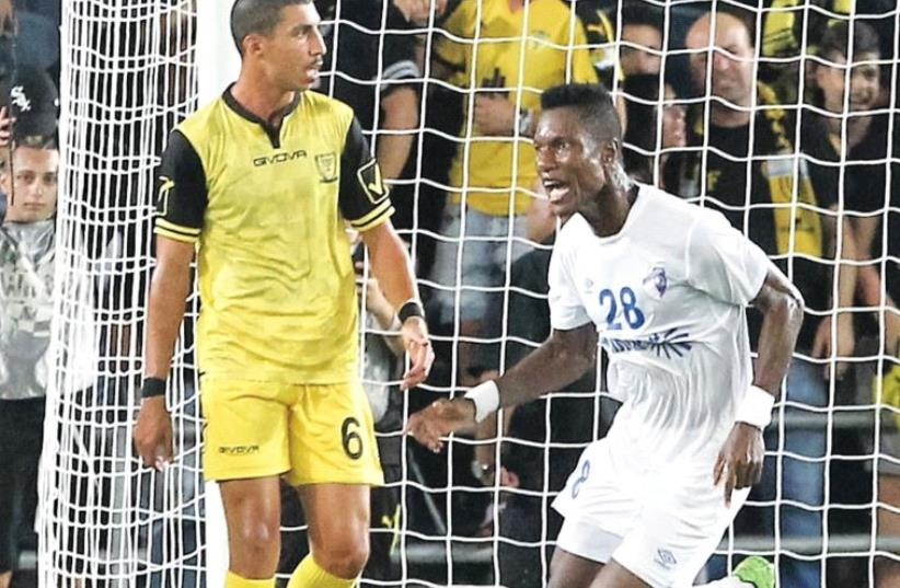 Ironi Kiryat Shmona midfielder Didier Brossou (right) celebrates after netting a 94th-minute equalizer in the 2-2 draw with Tal Kahila (left) and Beitar Jerusalem at Teddy Stadium last night. (photo credit: DANNY MARON)