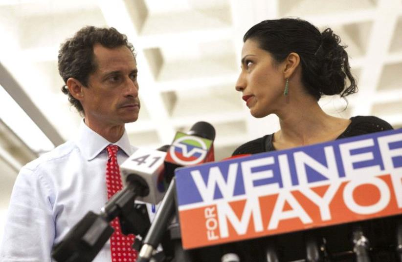 New York mayoral candidate Anthony Weiner and Huma Abedin, a top aide to Democratic presidential candidate Hillary Clinton (photo credit: REUTERS)