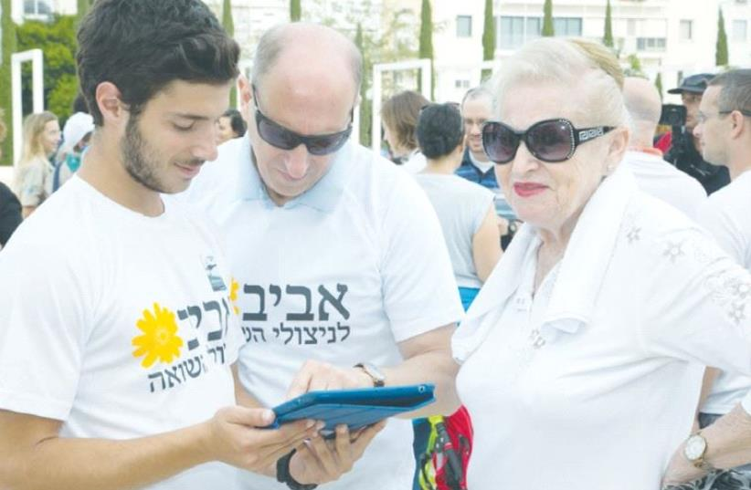 AVIV VOLUNTEERS aid a client. (photo credit: Courtesy)