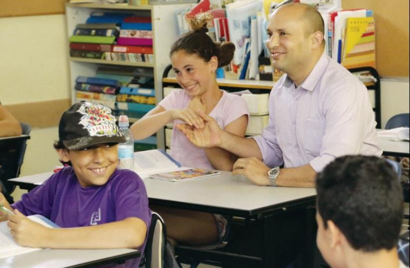 Education Minister Naftali Bennett meets with pupils at the start of the 2015/16 school year (photo credit: SASSON TIRAM)