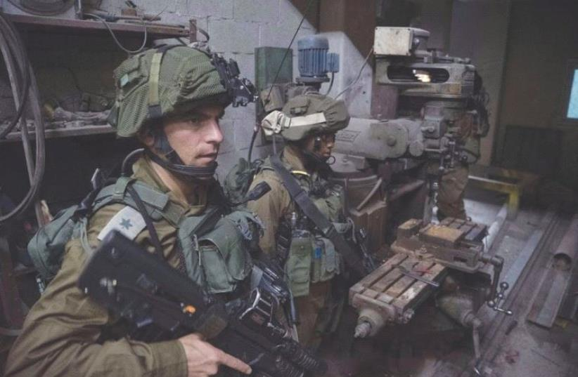 IDF TROOPS raid a West Bank weapons workshop this week. (photo credit: IDF SPOKESPERSON'S UNIT)