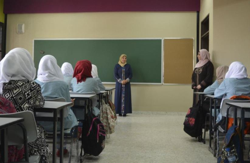 Students in classroom at Aqqaba Secondary Girls' School. (photo credit: UDI SHAHAM)