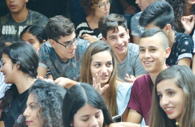 ARAB AND JEWISH STUDENTS gather on the first day of school Thursday at Jerusalem's bilingual Max Rayne Hand in Hand School. (photo credit: AMAL MATTAR)