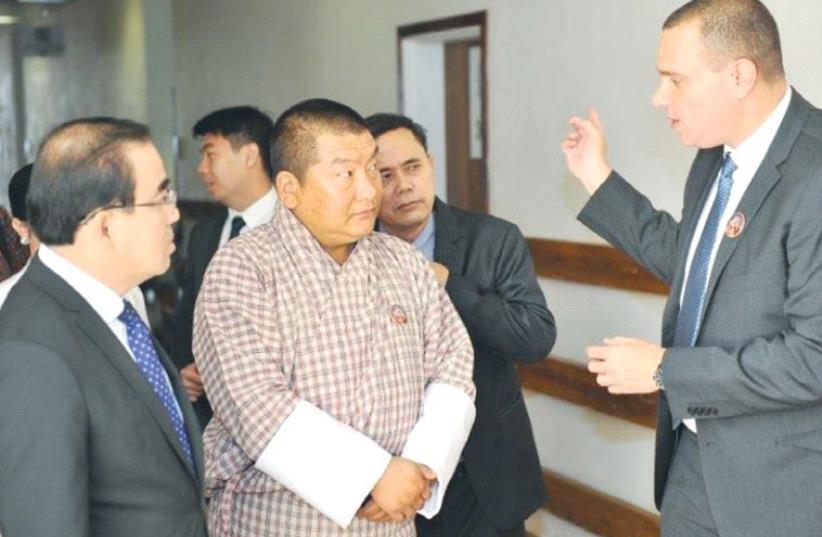 YARON TAMIR of Agrostudies speaks to Bhutanese Agriculture Minister Lyonpo Yeshey Dorji (center) and Cambodian Agriculture Minister Veng Sakhon in Jerusalem. (photo credit: ADI TURGEMAN)